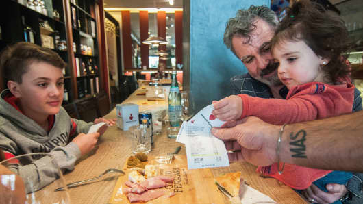 A family receives the bill with the discount of 5% for the good behavior of one child in the Antonio Ferrari restaurant on February 15, 2017 in Padova, Italy.