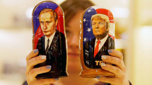 Russian nesting dolls, bearing the faces of Vladimir Putin and Donald Trump.