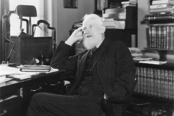 Irish dramatist George Bernard Shaw (1856 - 1950) at his flat in London.
