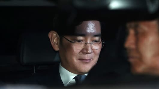 Jay Y. Lee, co-vice chairman of Samsung Electronics, center, sits in a car as he leaves the Seoul Central District Court in Seoul, South Korea, on Thursday, Feb, 16, 2017.