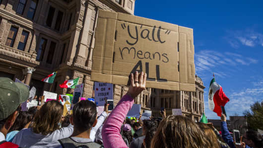 Protesters march in the streets outside the Texas State Capitol on 'A Day Without Immigrants' February 16, 2017 in Austin, Texas