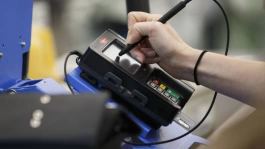 A customer signs for a purchase with a chip credit card at a Wal-Mart location in Burbank, California.