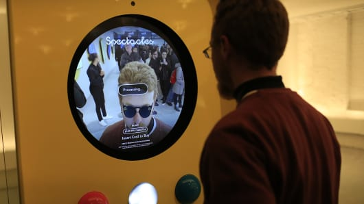A monitor illustrates how a customer will look wearing Snapchat Spectacles by Snap Inc. while making a purchase at the company's pop-up store in New York, U.S., on Monday, Dec. 5, 2016.