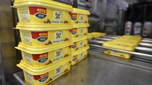 A picture taken on June 5, 2015 shows margarines on the packaging line at the Unilever's factory in Rotterdam.