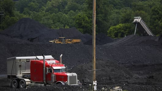 A tractor-trailer navigates mounds of coal after delivering a truckload of coal to Arch Coal Terminals in Catlettsburg, Kentucky.