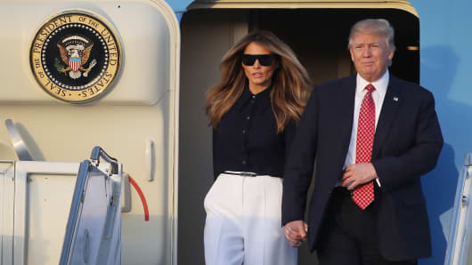 President Donald Trump and his wife Melania Trump arrive on Air Force One at the Palm Beach International airport as they prepare to spend part of the weekend with Japanese Prime Minister Shinzo Abe and his wife Akie Abe at Mar-a-Lago resort on February 10, 2017 in West Palm Beach, Florida.