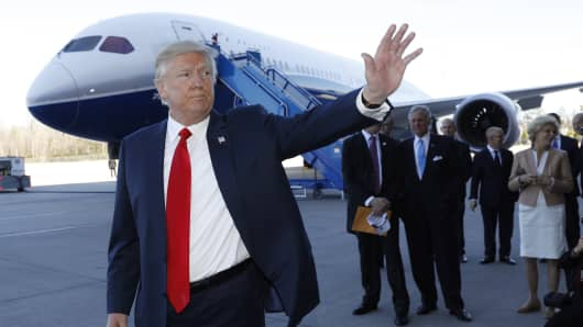 President Donald Trump waves after speaking at the debut of the Boeing South Carolina Boeing 787-10 Dreamliner in North Charleston, South Carolina, U.S., February 17, 2017.