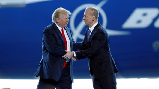 President Donald Trump greets Boeing Chairman, President and CEO Dennis Muilenburg during a ceremony celebrating the rollout of the Boeing 787-10 Dreamliner at the Boeing South Carolina plant in North Charleston, South Carolina, February 17, 2017.
