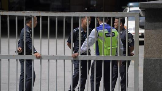 Members of the Royal Malaysian Police man the main gate of the forensics wing of the Hospital Kuala Lumpur in Kuala Lumpur on February 18, 2017.
