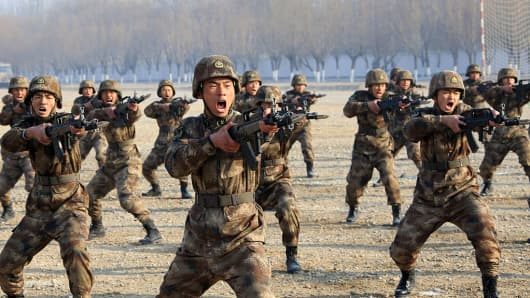 Army officers and soldiers in action during a drill on January 3, 2017 in Yinchuan, Ningxia Hui Autonomous Region of China.