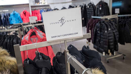 A sign for Ivanka Trump brand is displayed atop a rack of Ivanka Trump brand coats at the Century 21 department store on February 10, 2017 in New York City.