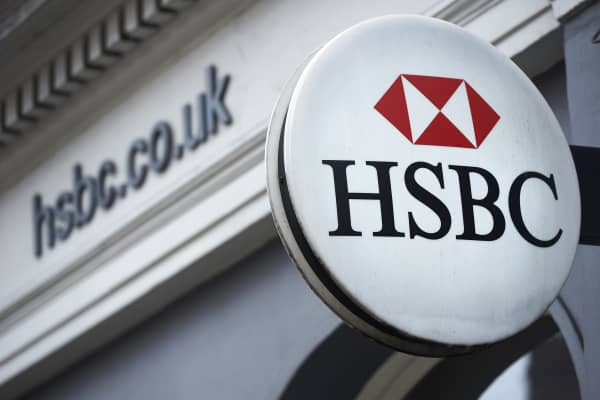 A HSBC bank logo is seen on a sign outside a branch of the bank in central London.