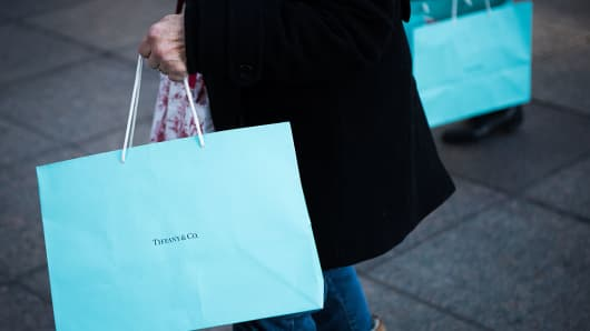Shoppers carry Tiffany & Co. bags