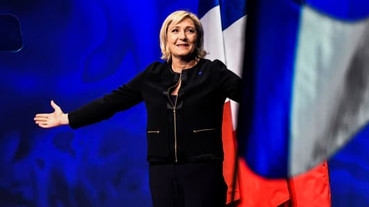 French presidential candidate and head of the far-right National Front party Marine Le Pen arrives on stage to give a speech on February 5, 2017.