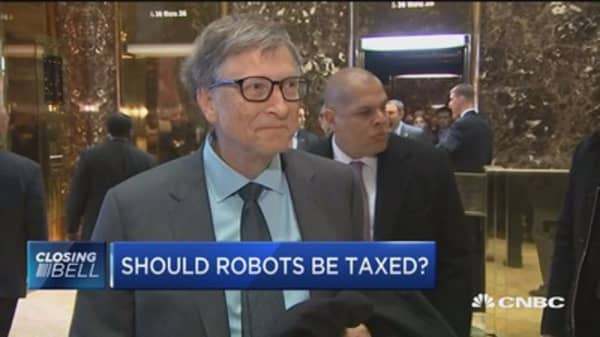 Gates: Robot tax would slow down automation