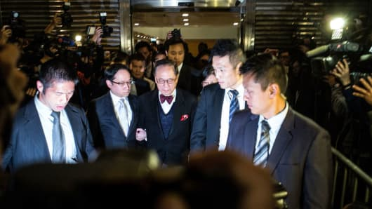 Former Hong Kong Chief Executive Donald Tsang and his wife Selina Tsang Pou Siu-mei leave High Court on February 17, 2017 in Hong Kong.
