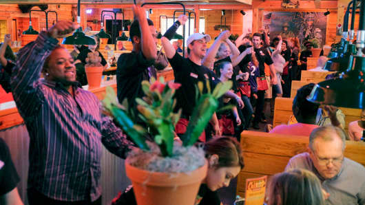 Employees line dance in the restaurant aisles during the opening day of Texas Roadhouse in Nottingham, MD.