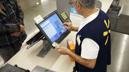 A cashier completes a purchase at a Walmart store in Burbank, California.