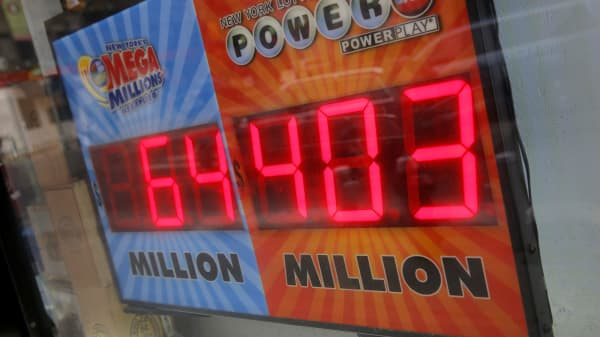 A sign advertises the Powerball jackpot outside a store on Kenmare Street in New York, February 22, 2017.