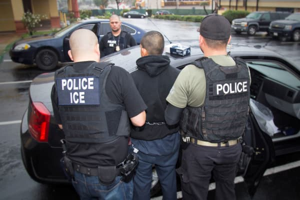 U.S. Immigration and Customs Enforcement (ICE) officers detain a suspect as they conduct a targeted enforcement operation in Los Angeles, California, U.S. on February 7, 2017.