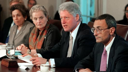President Bill Clinton speaks to reporters before the start of a Cabinet meeting, 28 September 2000, at the White House in Washington, DC. Seated with Clinton L-R are Secretary of Health and Human Services Donna Shalala, Secretary of State Madeleine Albright and White House Chief of Staff John Podesta.