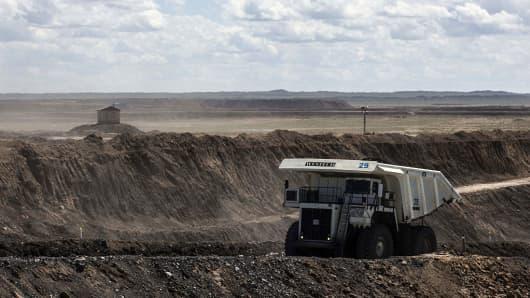 A dump truck travels through the open pit at the Tavan Tolgoi coal deposit on Tsogtsetsii, Ömnögovi Province, Mongolia, on Friday, July 22, 2016.