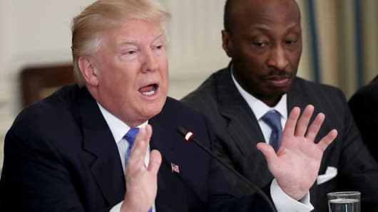 President Donald Trump speaks during a listening session with manufacturing CEOs in the State Dining Room of the White House February 23, 2017 in Washington, DC.  Also pictured is Kenneth Frazier (R) CEO of Merck & Company.
