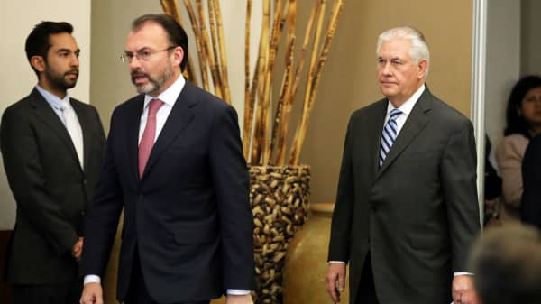 U.S. Secretary of State Rex Tillerson (R) and Mexico's Foreign Secretary Luis Videgaray arrive to deliver a statement at the Ministry of Foreign Affairs in Mexico City, Mexico February 23, 2017.