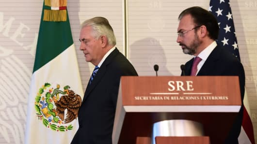 Secretary of State Rex Tillerson (L) and Mexican Foreign Minister Luis Videgaray arrive to a joint press conference at the Foreign Ministry building in Mexico City on February 23, 2017.
