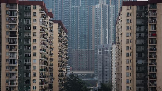 Residential buildings stand in the Mei Foo area of Hong Kong, China, on Wednesday, Feb. 3, 2016.