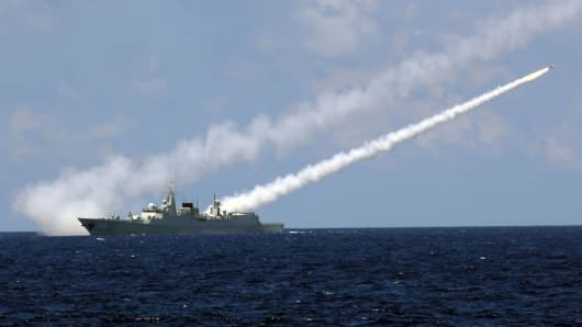 Missile destroyer Guangzhou launches an air-defense missile during a military exercise near south China's Hainan Island and Xisha islands, July 8, 2016.