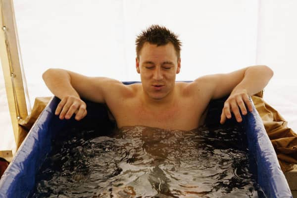 English soccer player John Terry sits in an ice bath to assist recovery from an injury.