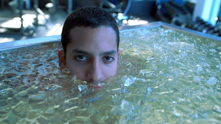 Magician, David Blaine soaks in a water bath full of ice.
