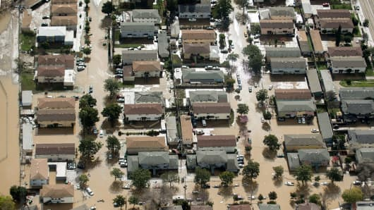Floodwaters surround homes and cars on February 22, 2017, in San Jose, California.
