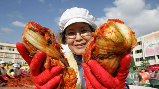 South Koreans make 'kimchi', a traditional pungent vegetable dish.