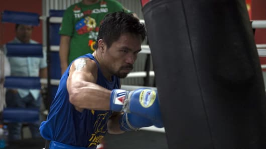 In this photo taken on September 29, 2016, Philippine boxing icon Manny Pacquiao trains at a gym in Manila.