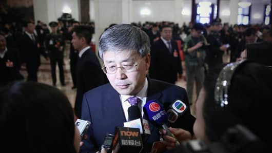 Guo Shuqing answers media questions before the second plenary session of China's parliament, the National People's Congress (NPC), at the Great Hall of the People on March 8, 2015 in Beijing, China.