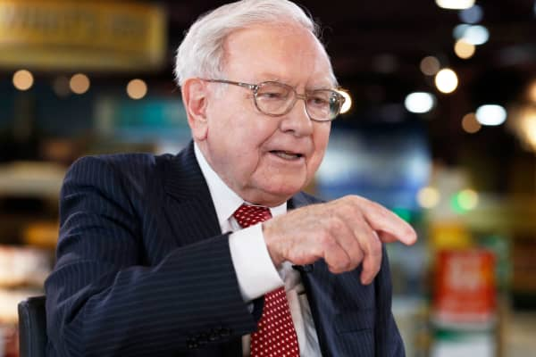 Image result for Berkshire profit falls as investment gains tumble images