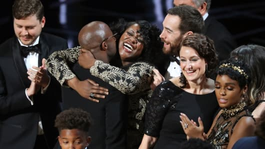 """Joi McMillon and cast of """"Moonlight"""" celebrate Best Picture award, February 26, 2017."""