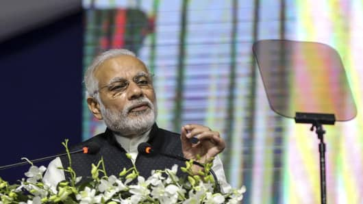 Narendra Modi, India's prime minister, gestures as he speaks during an inauguration of the India International Exchange
