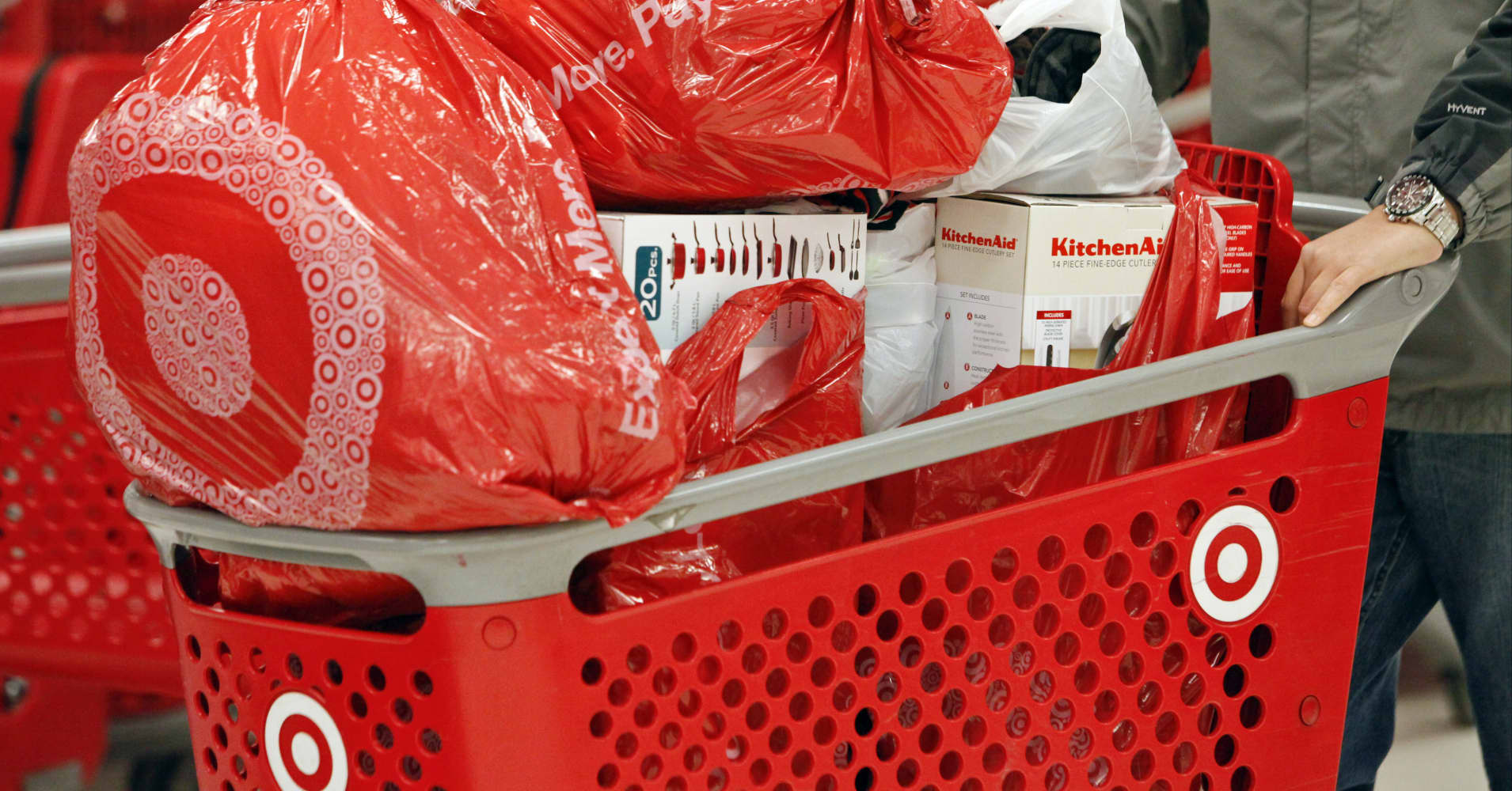 A customer pushes a shopping cart laden with merchandise at a Target store opening ahead of Black Friday in Chicago.