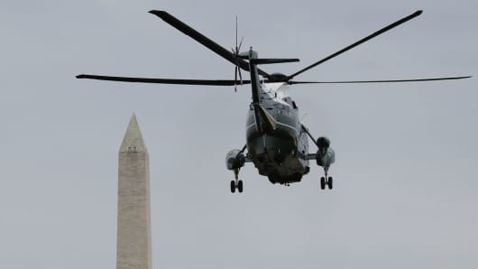 Marine One carrying U.S. President Donald Trump, takes off from the White House, on February 1, 2017 in Washington, DC. Trump made the trip to Dover Air Force base in Delaware to pay his respects to Chief Special Warfare Operator William 'Ryan' Owens, who was killed during a raid in Yemen.