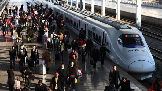 Passengers get off trains at Nantong Railway Station on January 23, 2017 in Nantong, Jiangsu Province of China.