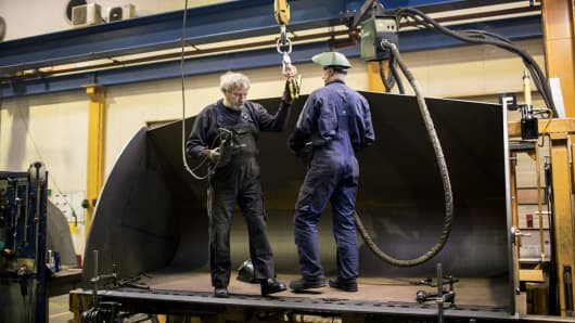 Two older employees at the Danish machinery manufacturer Sjorring Maskinfabrik, which has struggled with a shortage of skilled workers, in Thisted, Denmark, Feb. 7, 2017.