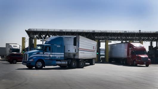 Trucks from Mexico enter a U.S. Customs and Border Protection inspection station at the Otay Mesa Port of Entry in San Diego.