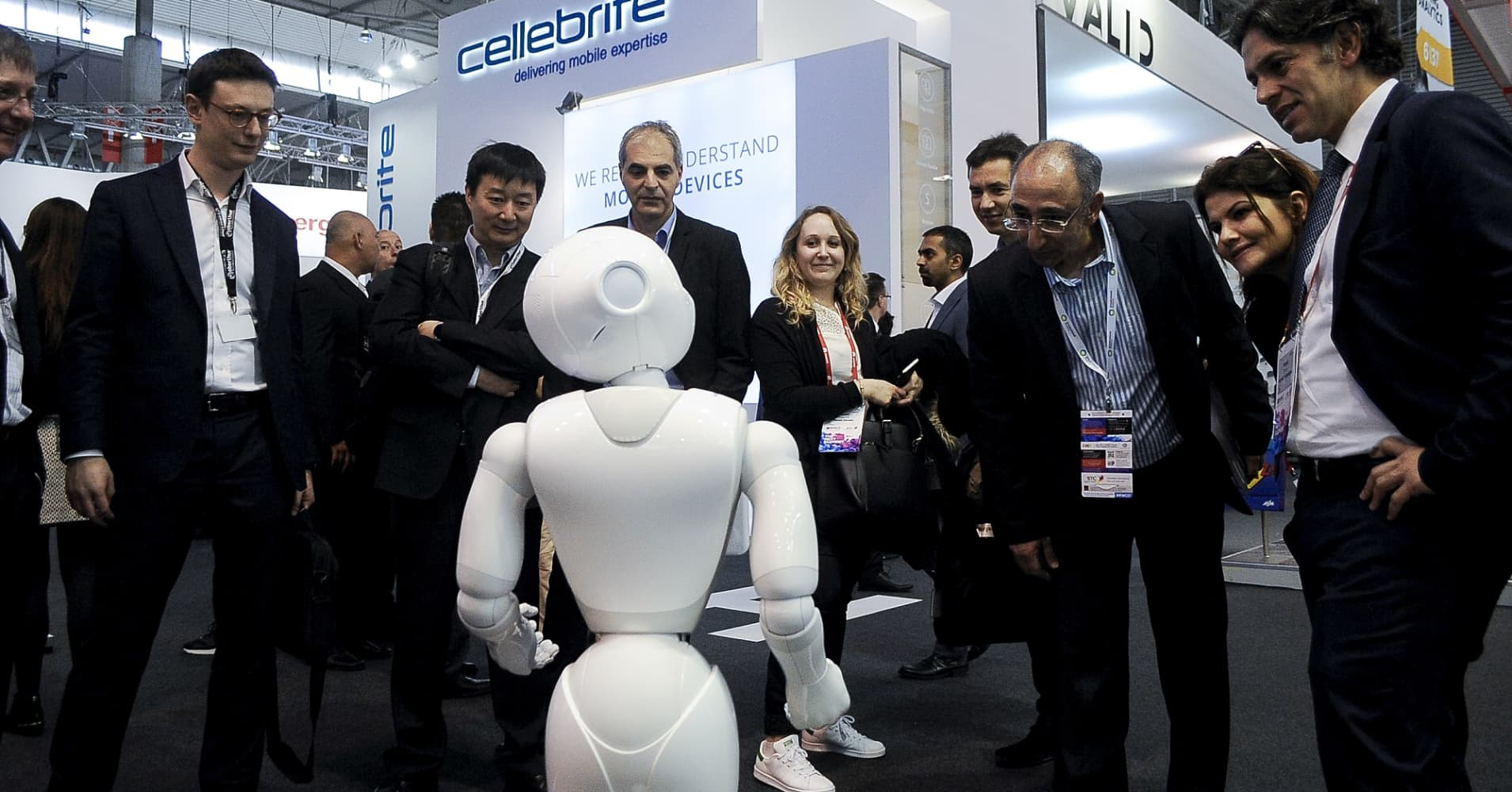 Congess attendees speak with a robot during the Mobile World Congress, on February 27, 2017 in Barcelona, Spain.
