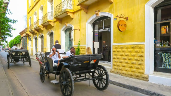 Tourists in a horse-drawn carriage in Cartagena, Colombia.