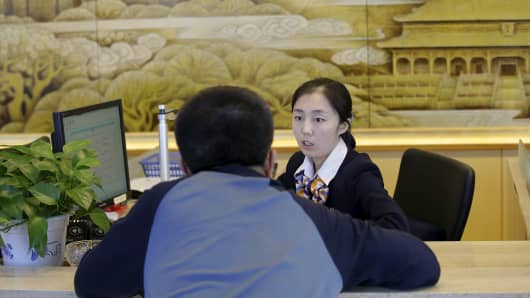 A customer at an insurance company branch in Beijing, China, on Mar. 24, 2016.
