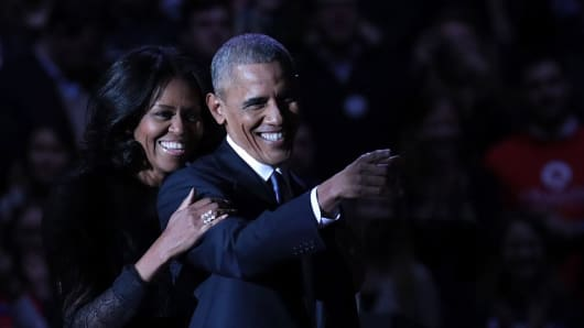 U.S. President Barack Obama and first lady Michelle Obama on stage after delivering his farewell address at the McCormick Place, on January 10, 2017 in Chicago, United States.