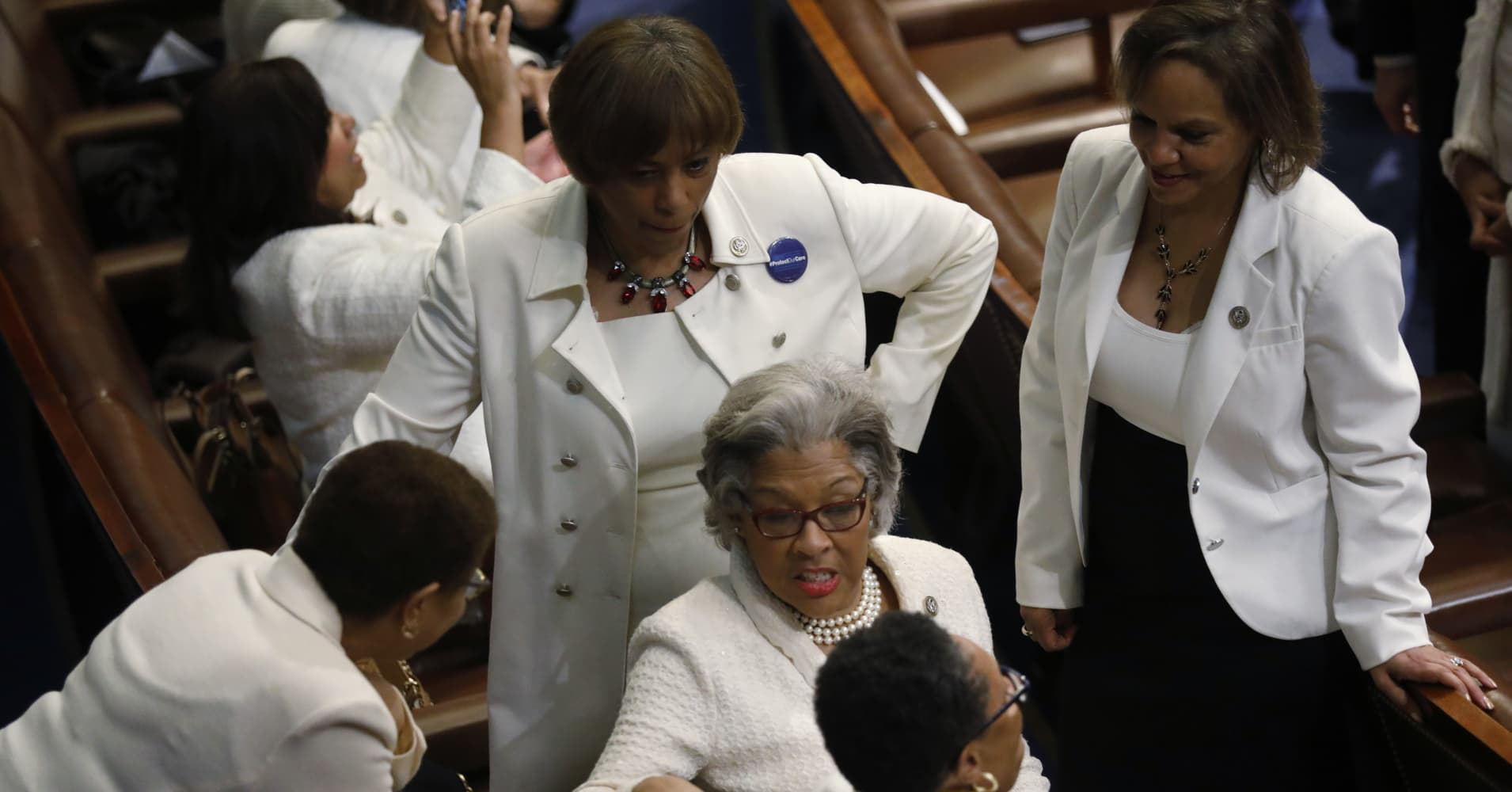 Democratic female members of the House of Representatives talk before U.S. President Donald Trump addresses the U.S. Congress.